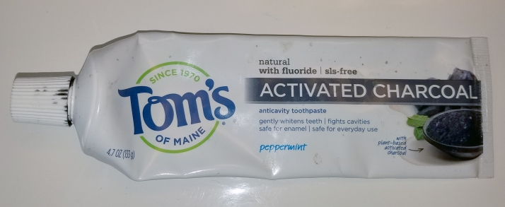 A tube of Tom's of Maine activate charcoal toothpaste.